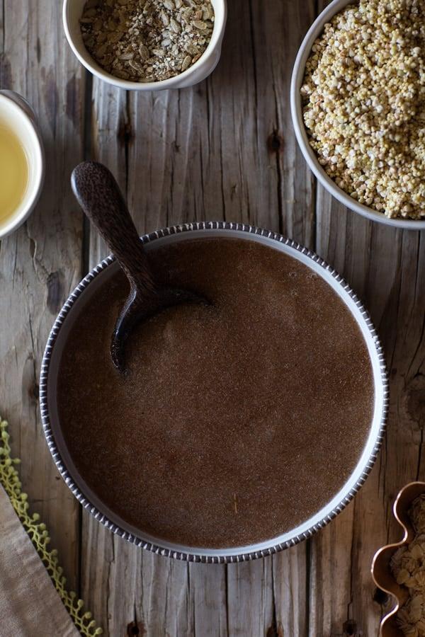 Ingredients for buckwheat bread on a wooden board