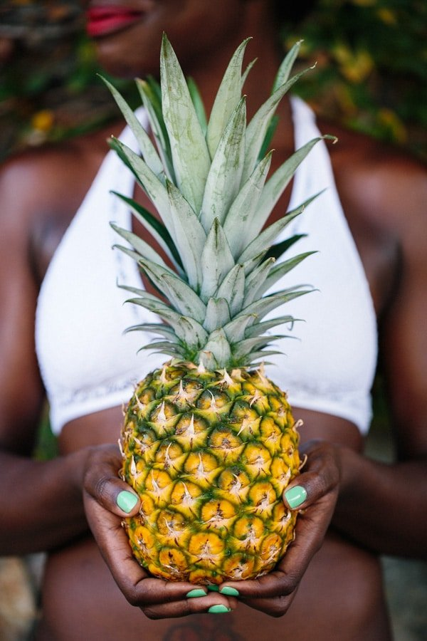 Woman holding a pineapple