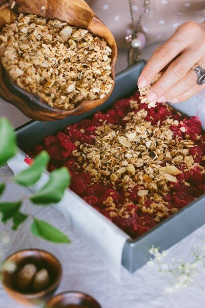 Almonds being poured in Raspberry mix for Breakfast Bars