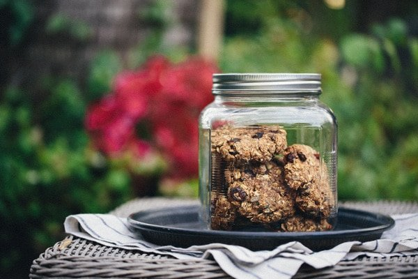 A jar of vegan and gluten free breakfast bars photographed outdoors
