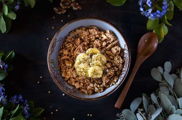 Overhead view of banana granola in a bowl with a spoon on the side