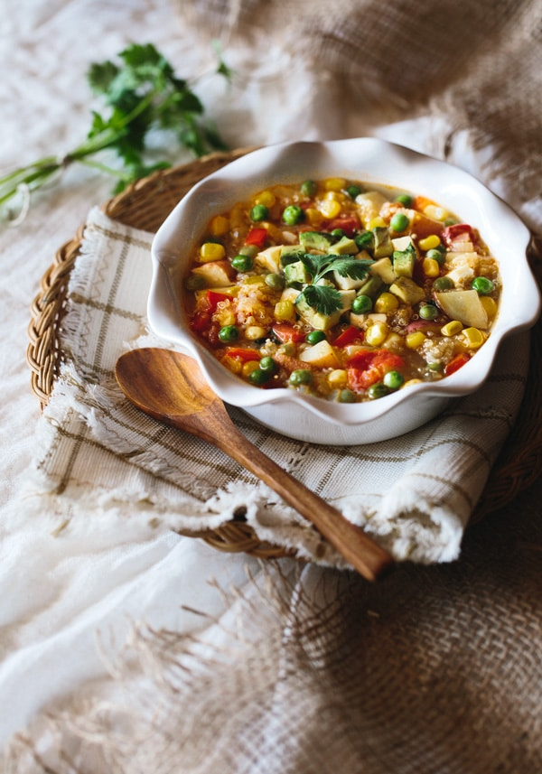 This quinoa and vegetable stew is a veggie packed gluten-free stew that you can make on a weeknight. I flavored it with some queso fresco, but if you are vegan feel free to omit the cheese to make it vegan friendly.