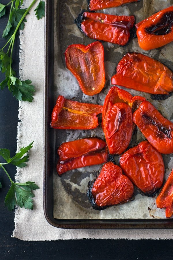 Red peppers are roasted to make Roasted Red Pepper Dip and photographed from the top view.