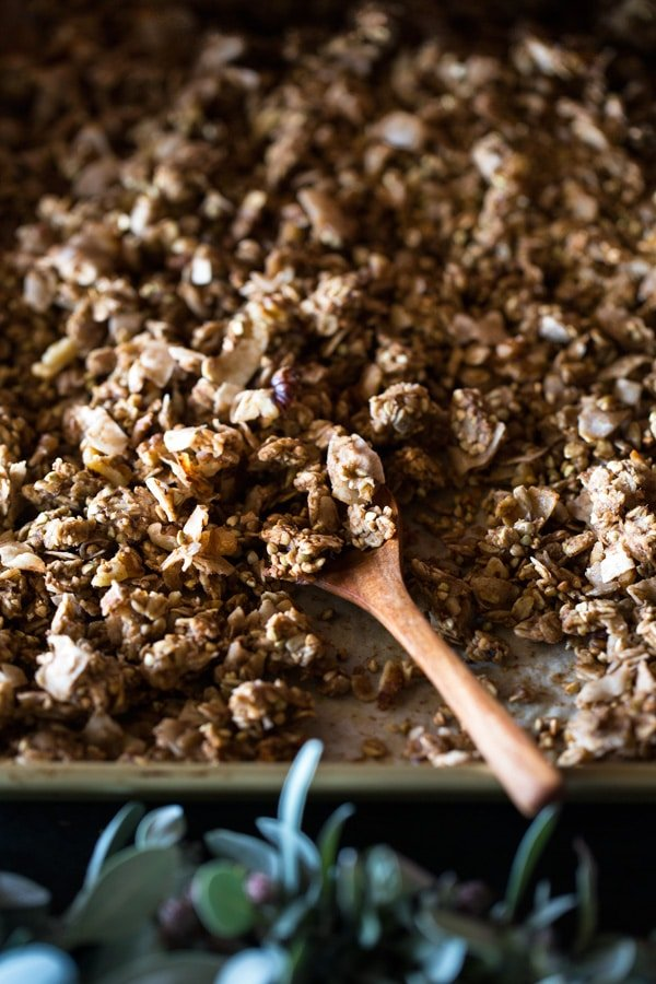 Close up of Chunky Banana Bread Granola with Chocolate Almond Milk with a wooden spoon