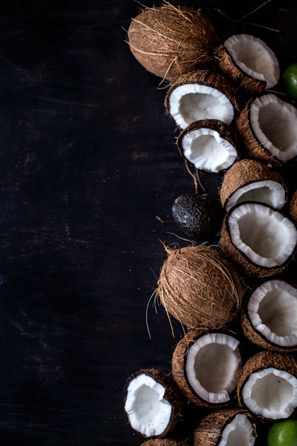 cracked fresh coconut with avocado and lime