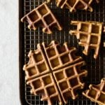 Spicy Pumpkin Waffles with Coconut Whipped Cream on a baking rack