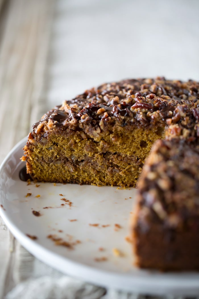 Close up shot of sliced Pumpkin Coffee Cake with Cocoa Vanilla Glaze