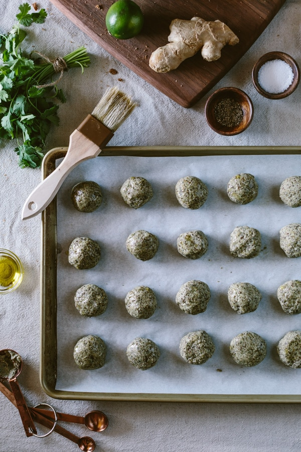 Rolled balls of dough for Curried Lentil Meatballs on a sheet pan