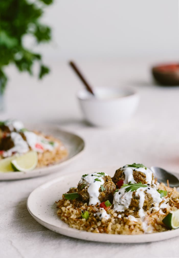 Plate of Curried Lentil Meatballs with bulgur and yogurt sauce
