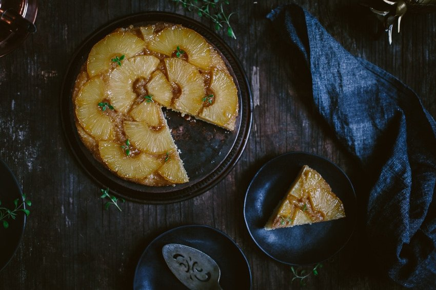Overhead view of Upside Down Pineapple Cake with one slice removed and placed on a plate