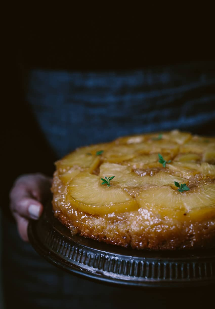 Close view of a person holding an Upside Down Pineapple Cake