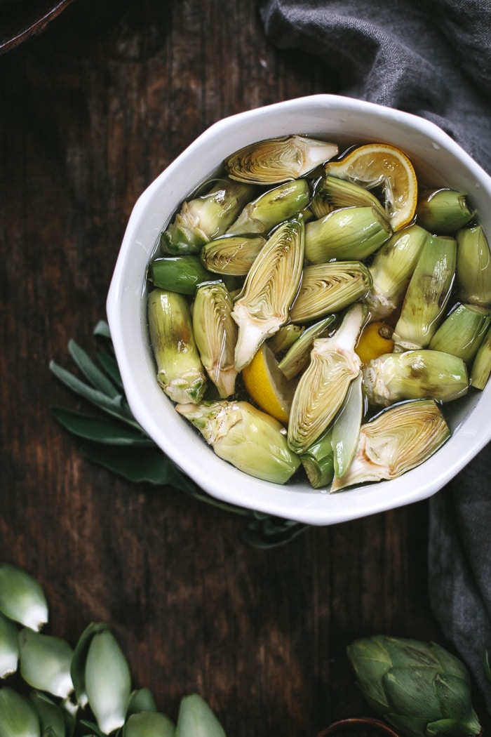 Close up view of sliced artichokes in a bowl