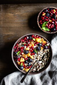 Quinoa Breakfast Porridge topped off with fruits and granola