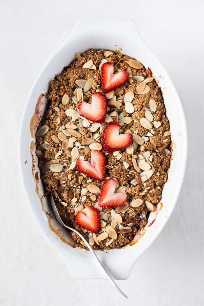 Freshly baked rhubarb breakfast recipe with strawberries top view