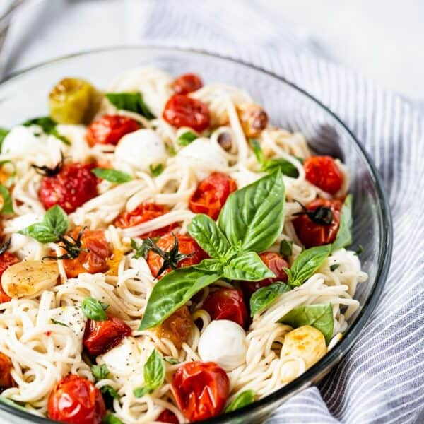 Caprese Pasta Salad Recipe placed in a large bowl garnished with basil