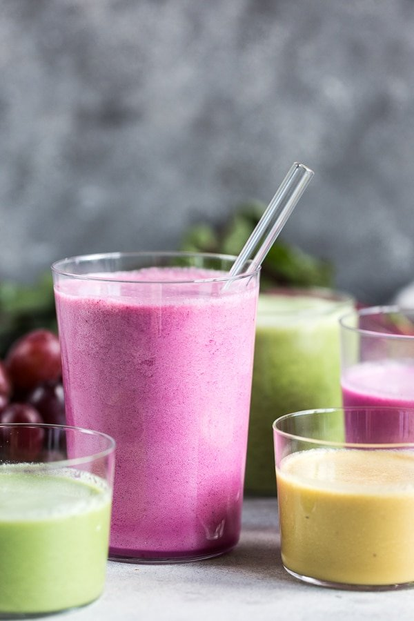 Beet smoothies made with golden beets, red beets, and spinach are in glasses.