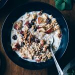 A heart warming farro breakfast bowl recipe with Cinnamon, apples, and cranberries. A perfect breakfast recipe for fall.