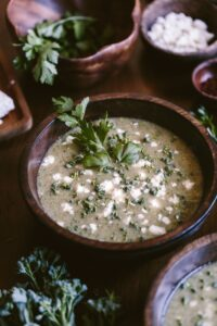 A bowl of Feta Broccoli Soup garnished with parsley