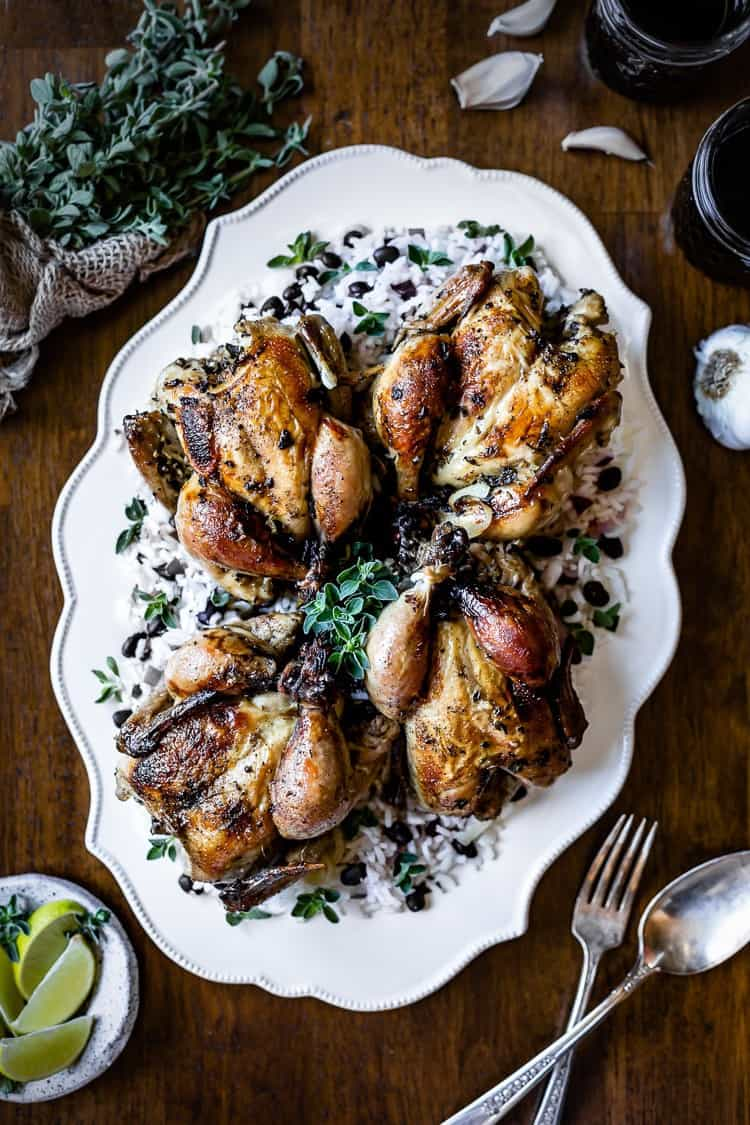 Roasted Cornish Hens placed on a large plate and photographed from the top view.