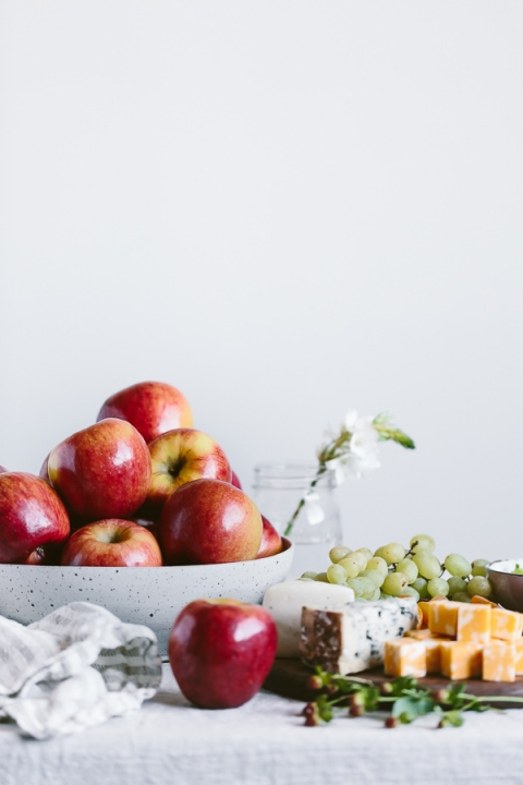 """Cheesy Apple Bites with Walnuts, Celery, and Pomegranate Seeds: The easiest appetizer made with apple """"crackers"""" topped off with cream cheese, walnuts, celery, and drizzled with honey."""