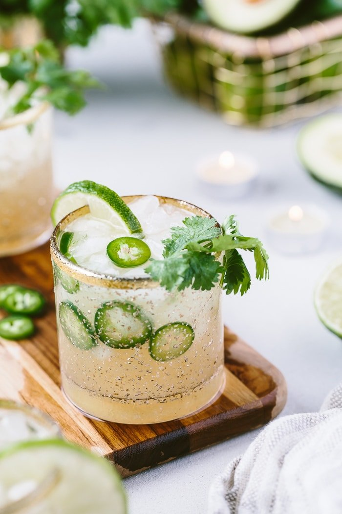 Spicy Margarita Recipe on a wooden boar garnished with lime