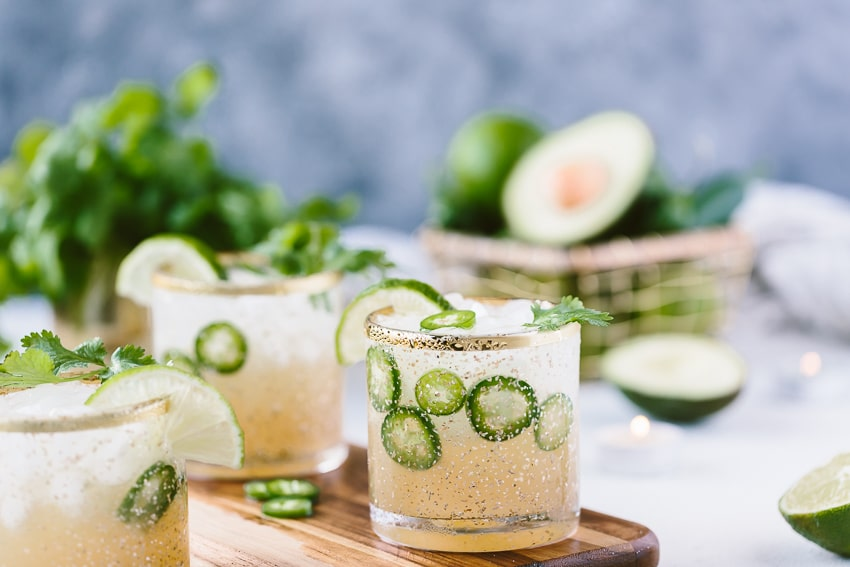 Spicy Jalapeño Margarita Recipe divided in between 3 glasses and garnished with lime