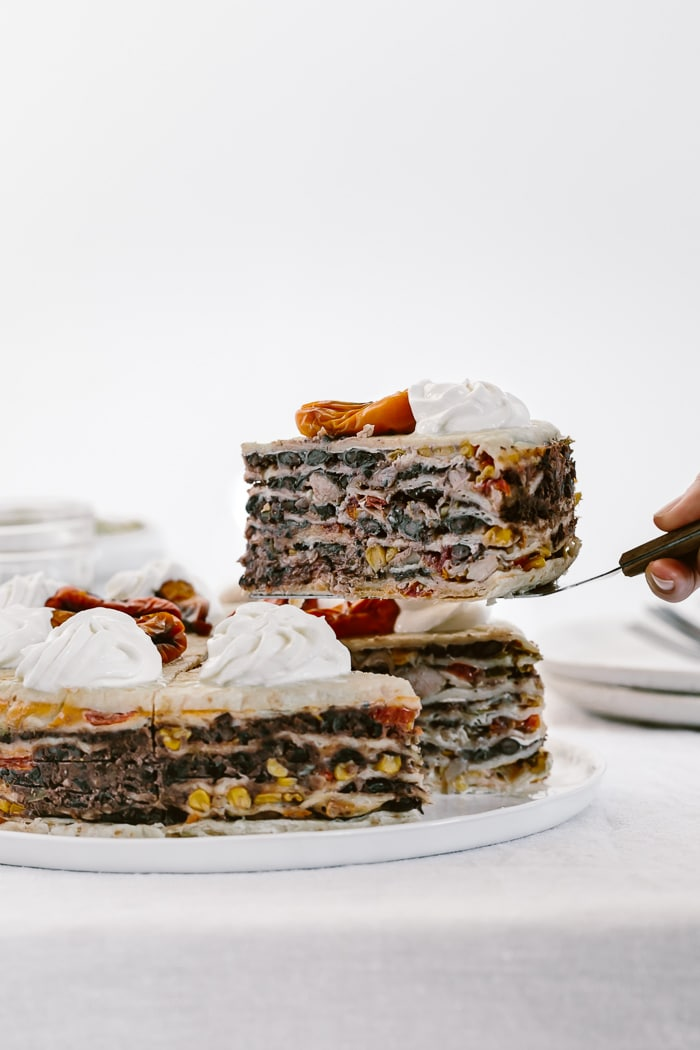 A slice of Chicken Quesadilla Cake removed from quesadilla cake