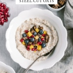 A bowl of cooked slow cooker steel cut oats is photographed from the top view.