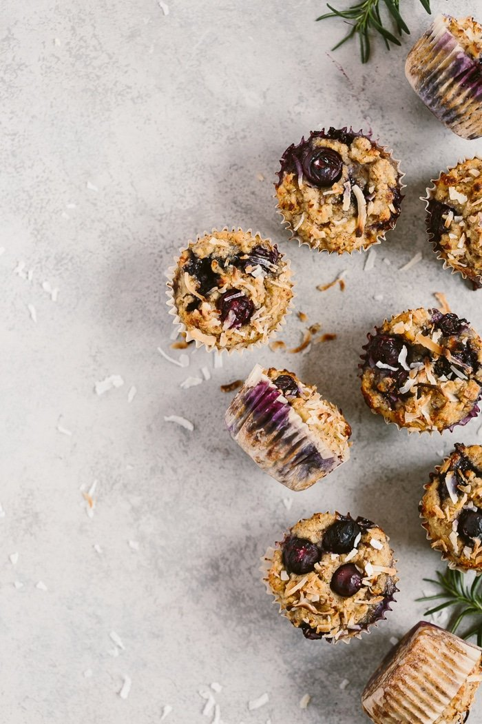 Flourless Blueberry Muffins placed on a light backdrop