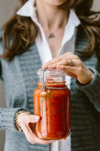 A foolproof recipe for homemade tomato basil sauce recipe with tips and tricks on storing and freezing.