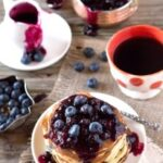 Lemon Ricotta pancakes topped off with blueberries and blueberry sauce