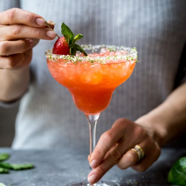 Strawberry Champagne Margaritas being served by a woman