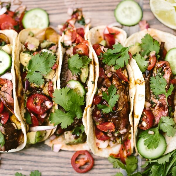 Grilled Flank Steak Tacos place in a cutting board and garnished with cilantro