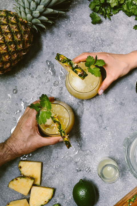 Spicy Pineapple Jalapeno Mezcalita - A refreshing cocktail made with Mezcal, pineapple, jalapenos, and cilantro.