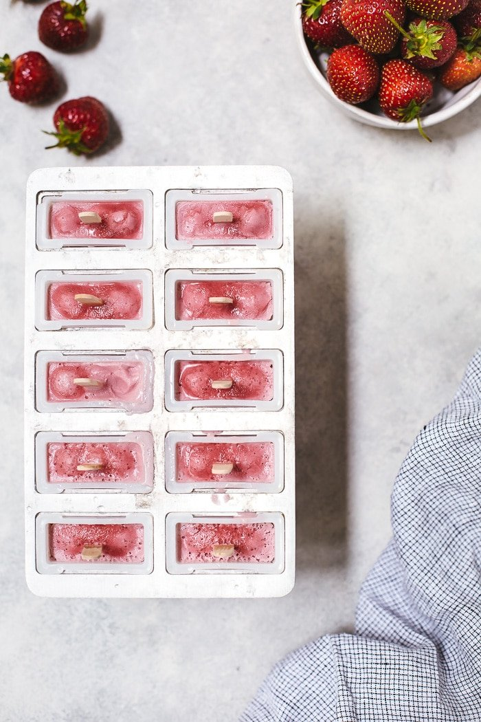 Vegan Minty Strawberry Coconut Milk Popsicles - A healthier summer popsicle recipe sweetened with fresh strawberries and a little bit of maple syrup.