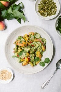 Fresh Peach Avocado Salad: A vegan salad recipe made with fresh peaches, avocados, and cucumbers. Super flavorful and refreshing.