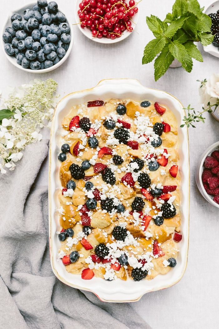 Maple Sweetened Mixed Berry Goat Cheese Bread Pudding Recipe: Toasted Brioche layered with goat cheese and summer berries for a scrumptious breakfast dish.