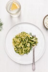 5 Ingredient Zucchini Noodles Recipe - A vegetarian spiralized zucchini noodle pasta recipe made with olive oil, garlic, dill and feta.