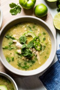 A bowl of Crockpot Chicken Tomatillo Soup Recipe served in a bowl with toppings