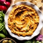roasted carrot hummus in a bowl close up from the top view