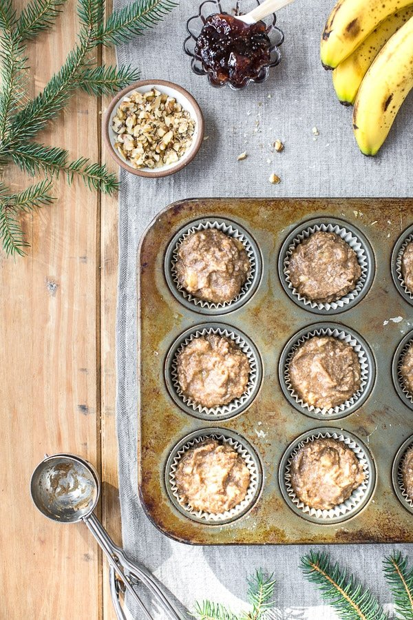 Easy Banana Nut Muffins are photographed from the top view in muffin tins.
