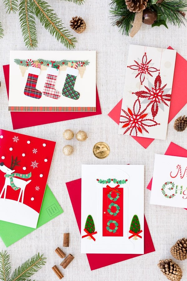 Beautiful Christmas greeting cards are displayed to be packed with the homemade chocolate almond bark