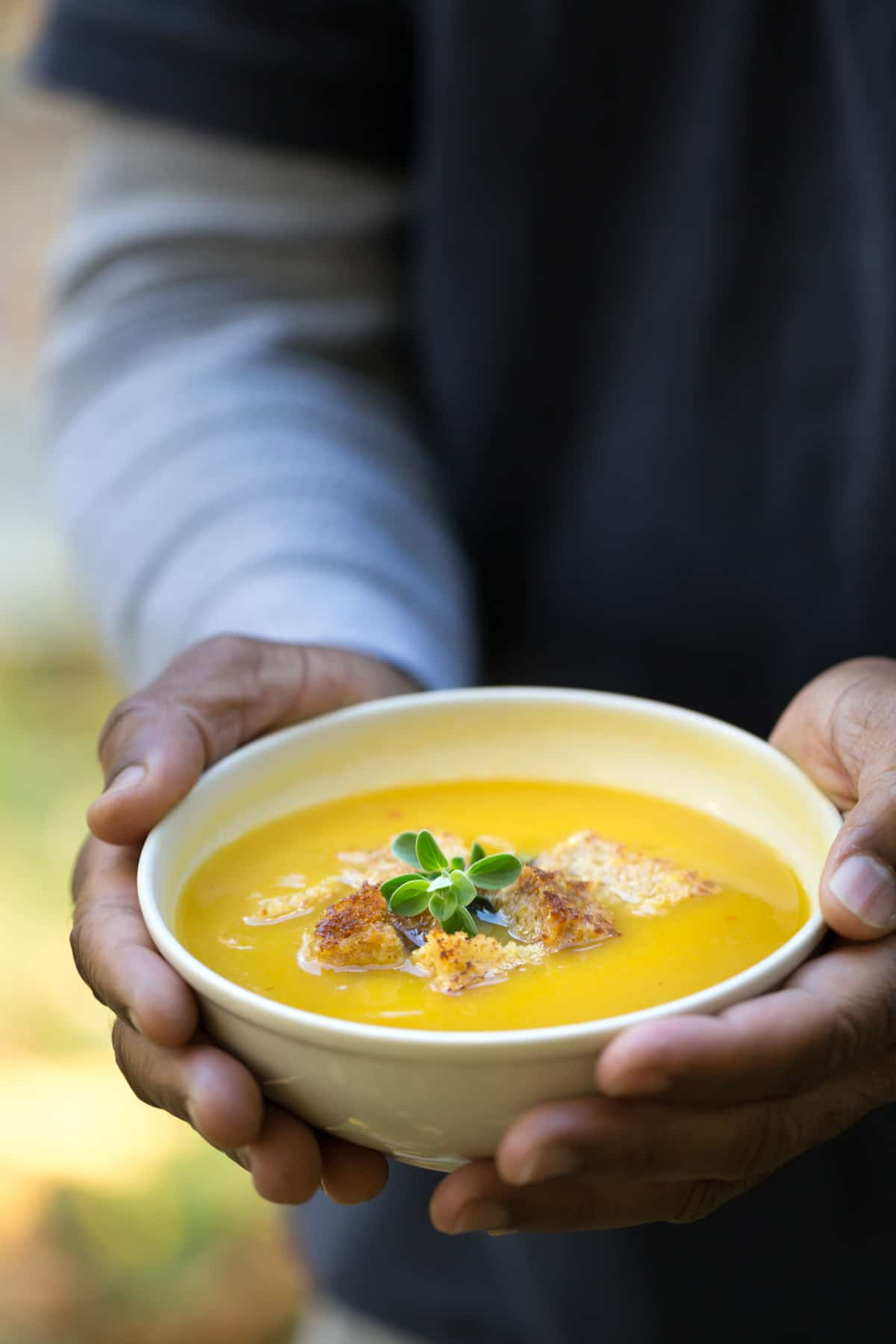 Dominican Style Pumpkin Ginger Soup topped off with croutons