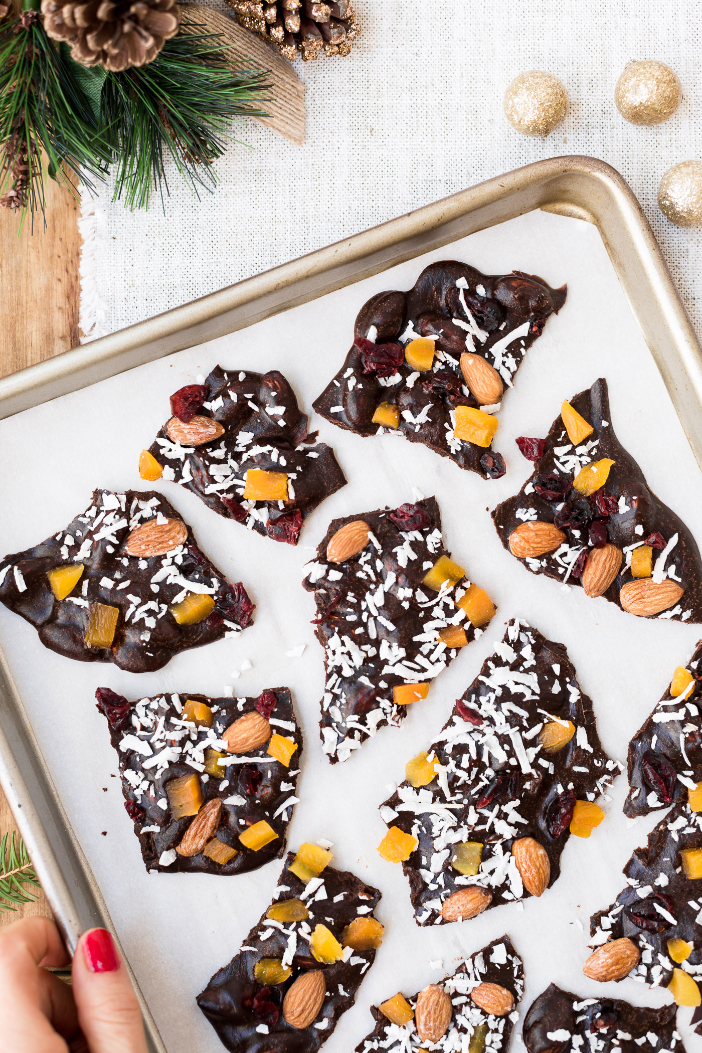 Foolproof Living's Best Chocolate Recipes For The Holiday Season: A Whole Chocolate Almond Bark cut into small shards and photographed from the top view.