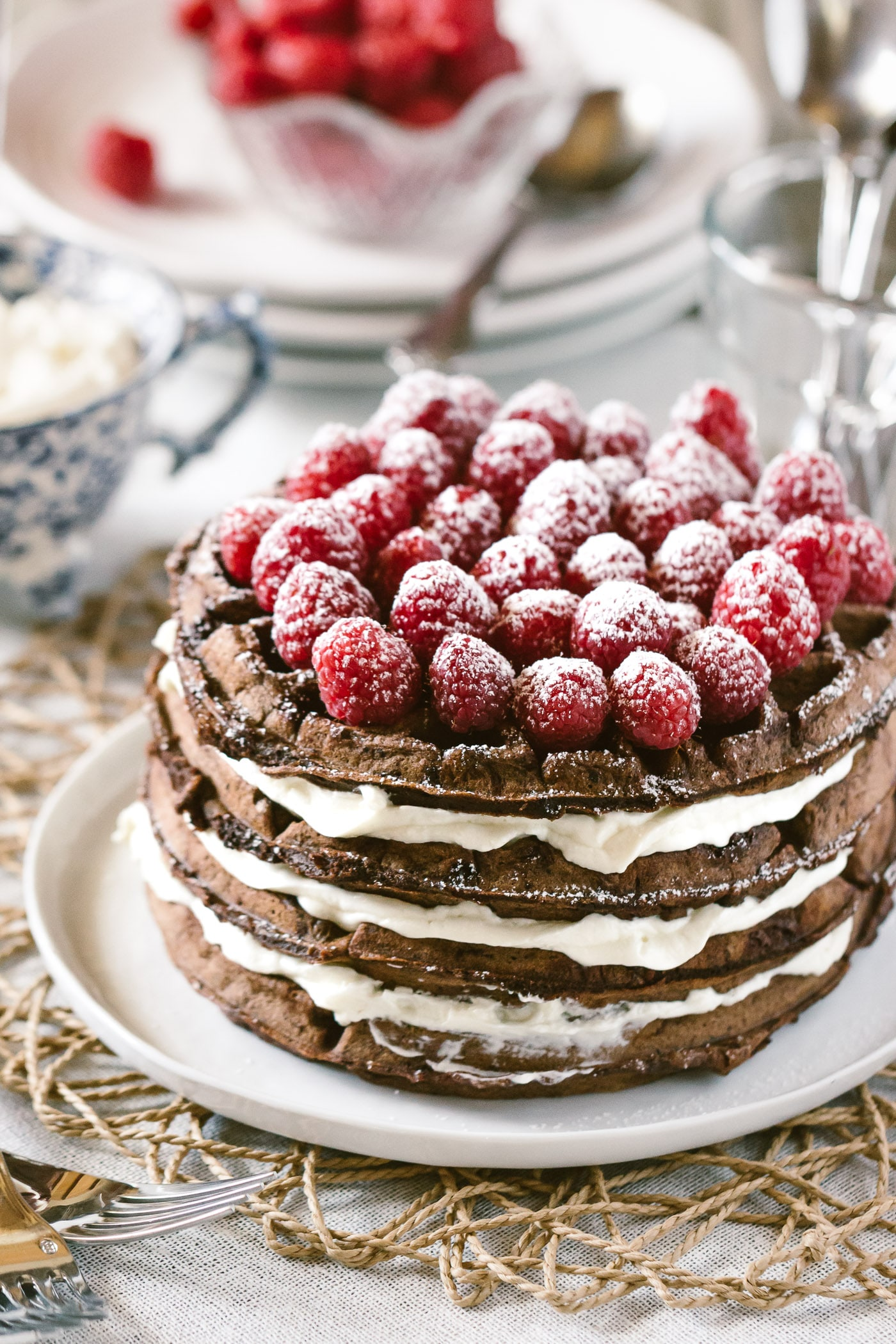 Foolproof Living's Best Chocolate Recipes For The Holiday Season: Dark Chocolate Waffle Cake with Mascarpone Whipped Cream topped off with raspberries - Photographed from the front view.