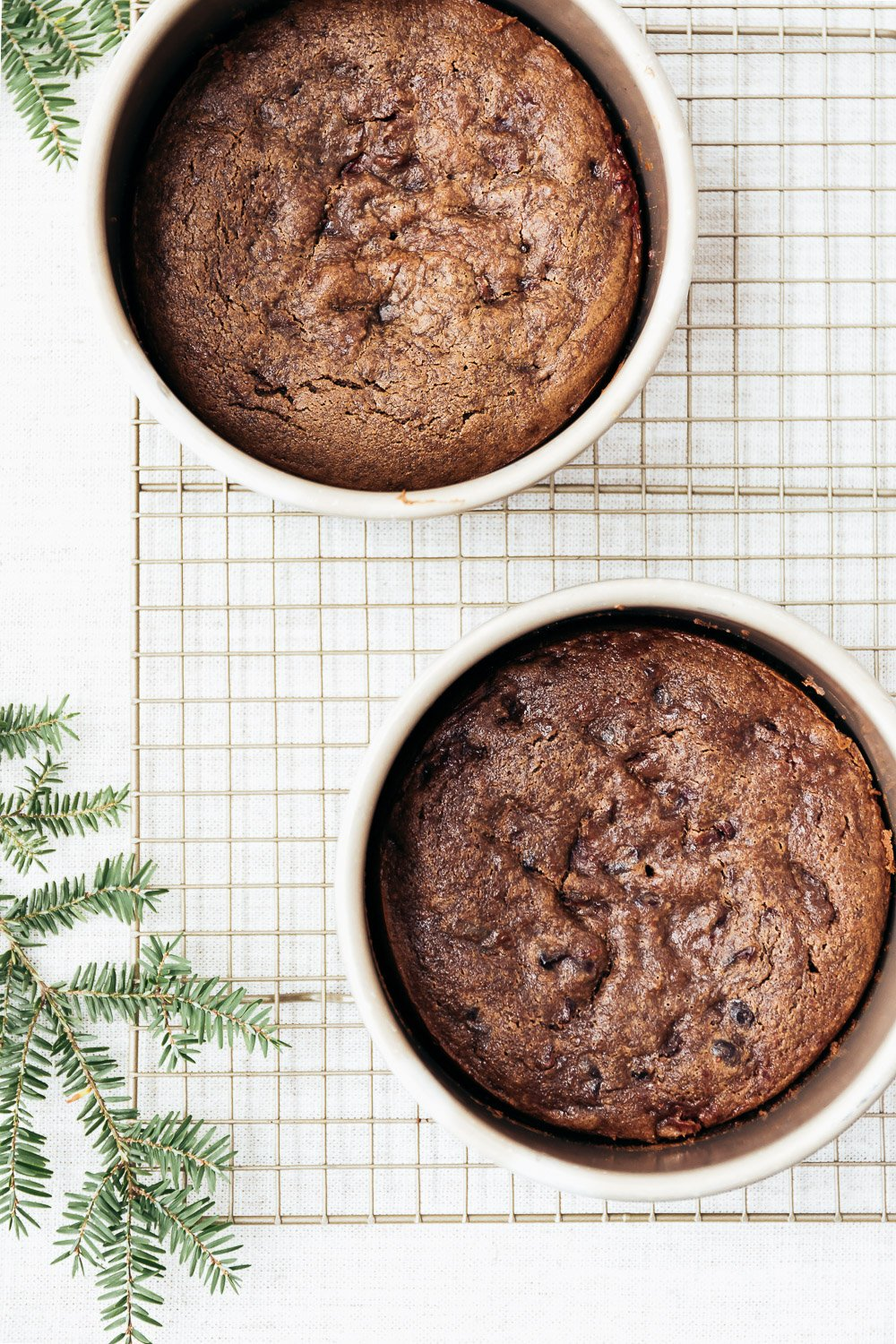 Freshly Baked Gluten Free Gingerbread Cakes are photographed right after they came out of the oven on a wire rack.