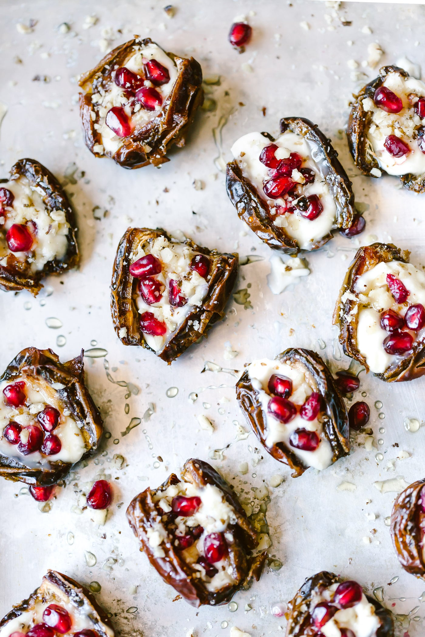 Mascarpone Stuffed Dates topped off with pomegranate arils photographed close up from the top view.