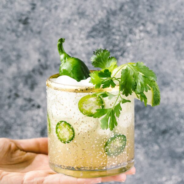 This Cilantro-infused Spicy Jalapeno Margaritas is the perfect balance between sweet, sour, and spicy all in one cocktail. Whether you make a serving for yourself or a big pitcher for a crowd, it will help you kick the cocktail hour up a few notches with very little effort.