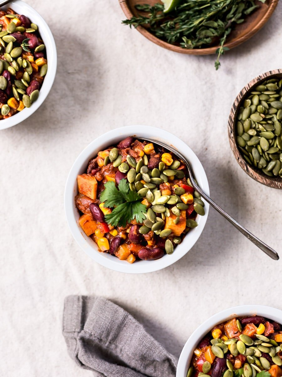 Several bowls of spicy vegan chocolate chili photographed from the top view.