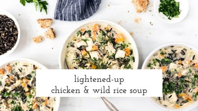 Three bowls of Lightened-Up Creamy Chicken and Wild Rice Soup are photographed from the top view.